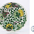 A fine famille verte <b>biscuit</b>-<b>enamelled</b> dish, Kangxi six-character mark within double-circles and of the period (1662-1722)
