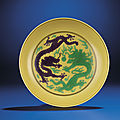 A fine yellow-ground green and aubergine enamelled 'dragon' dish, qianlong six-character seal mark and period (1736-1795)