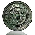 A large and rare bronze mirror with mythical animals and long inscription. <b>Sui</b> <b>dynasty</b> (581-618 AD).