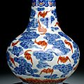 A <b>blue</b> <b>and</b> <b>white</b> <b>and</b> <b>iron</b>-<b>red</b> decorated bat <b>and</b> cloud vase, underglaze <b>blue</b> Guangxu mark <b>and</b> period (1875-1908)