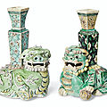 Two biscuit-glazed <b>Buddhist</b> lion vases, Kangxi period (1662-1722)