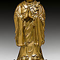 A gilt bronze of ananda, tibeto-chinese, ca. 16th century