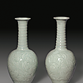 A rare pair of carved Qingbai 'Day Lily' vases, Song Dynasty (AD 960-1279)