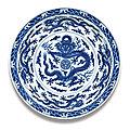 A fine <b>and</b> rare large <b>blue</b> <b>and</b> <b>white</b> 'dragon' dish, Qianlong seal mark <b>and</b> period (1736-1795)