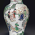A famille verte <b>baluster</b> <b>vase</b>, Kangxi period, dated to a winter day of the xinsi year, corresponding to 1701, and of the period