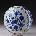 <b>Flask</b>, fritware underglaze-painted in blue on white, depicting a bird in flowers, dated 930H (1523-24), Nishapur, Iran