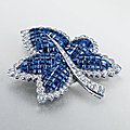 A 'mystery-set' sapphire and diamond brooch, by van cleef & arpels