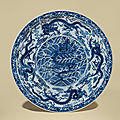 A large blue and white '<b>Nine</b> <b>dragons</b>' <b>dish</b>, Yongzheng six-character mark within double circles and of the period (1723-1735)