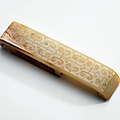 A white jade 'cloud scroll' scabbard slide, warring states period (475-221 bc)
