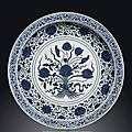 A rare large Ming-style blue and white '<b>Lotus</b> bouquet' dish, Qianlong six-character seal mark in underglaze-blue and of the peri