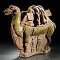 A green-brown glazed pottery group of a camel with a <b>calf</b>, Sui-Tang dynasty, 7th century