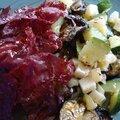 Salade tiède de courgettes, aubergines, piment, noisettes