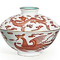 A Finely Enameled Iron-Red-Decorated Sgraffiato-Ground `Dragon And Phoenix' Bowl And A Cover, Qianlong Six-Character Seal Mark In Iron Red And Of The Period (1736-1795)