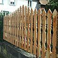 Palissade en bois en palines chantournees