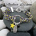 <b>Bracelet</b> liberty noir, gris, jaune et blanc, et ses breloques assorties, étoile jaune, fleur noir et matriochka !