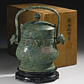 An archaic bronze ritual wine vessel and cover (you), Early Western Zhou Dynasty, <b>10th</b> <b>Century</b> BC