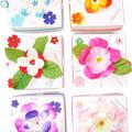 boîtes cadeaux carrées décorées de fleurs en relief et de cristal