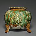 Asancai-glazedapplique-decorated tripod jar, <b>Tang</b> <b>dynasty</b> (<b>AD</b> <b>618</b>-<b>907</b>)