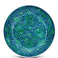 <b>A</b> rare large <b>underglaze</b>-<b>blue</b> ground green-enamelled 'dragon' dish, <b>Kangxi</b> <b>mark</b> and period
