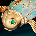 An opal, emerald and diamond brooch, <b>Oscar</b> <b>Heyman</b> & <b>Brothers</b>