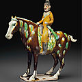 A superb and very rare painted andsancai-glazed pottery figure of an <b>equestrian</b> hunter, Tang dynasty (AD 618-907)