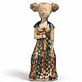 A very rare inscribed blue and amber-glazed pottery figure of a seated lady, Tang dynasty (618-907)