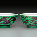 A pair of <b>aubergine</b> <b>and</b> <b>green</b>-<b>glazed</b> 'Dragon' bowls, Kangxi marks <b>and</b> period (1662-1722)