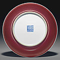 A copper-red-glazed dish, <b>Qianlong</b> <b>seal</b> <b>mark</b> in underglaze blue <b>and</b> <b>of</b> <b>the</b> <b>period</b> (1736-1795)
