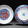 A pair <b>of</b> iron-red-decorated blue <b>and</b> white 'dragon' dishes, <b>Qianlong</b> <b>seal</b> <b>marks</b> <b>and</b> <b>of</b> <b>the</b> <b>period</b> (1736-1795)