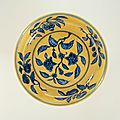 Dish with flower branches in blue on a yellow ground, Zhengde mark and period (1506 – 1521)