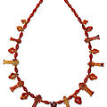 An Egyptian carnelian and agate bead and amuletic necklace, <b>Third</b> <b>Intermediate</b> <b>Period</b>, 21st-22nd dynasty, circa 1069-664 B.C.