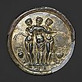 Gilded bronze mirror with the three graces. mid-imperial, antonine, mid-2nd century a.d.