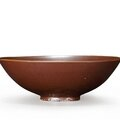An extremely rare dingyao purple-red glazed teabowl, Northern Song Dynasty (AD960-1127)