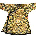 An Imperial yellow satin brocade <b>tibetan</b> -<b>style</b> 'dragon' robe (chuba), Qing dynasty, Kangxi period