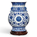 A rare large <b>blue</b> and white 'flower and butterfly' quatrefoilvase with elephant handles, seal mark and period of Qianlong