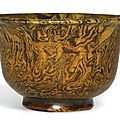 An amber-glazed marbled pottery cup, Tang dynasty