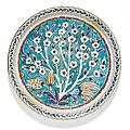 An Iznik <b>polychrome</b> <b>pottery</b> dish with a prunus tree, Turkey, circa 1575-85