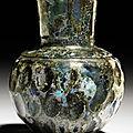 A wheel-cut blue glass bottle, North-East Iran, <b>9th</b>-<b>10th</b> <b>century</b>