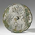 A <b>bronze</b> octalobed 'Flower and Fruit' <b>mirror</b>, Tang Dynasty (618-907)