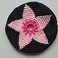Frisbee fleur rose pale