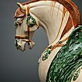 A large <b>sancai</b>-glazed figure of a caparisoned horse, Tang dynasty (618-907)