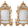 A pair of <b>George</b> <b>II</b> giltwood girandole mirrors, circa 1750, reduced in height