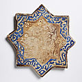 A Kashan lustre painted star-shaped tile with <b>rabbits</b>, early 14th century