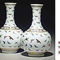 A pair of famille rose 'butterfly' vases, Guangxu six-character mark in iron red and of the period (<b>1875</b>-1908)