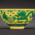 A <b>green</b> <b>and</b> <b>yellow</b> <b>enamelled</b> 'dragon <b>and</b> phoenix' bowl, Kangxi six-character mark within double-circles <b>and</b> of the period