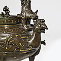 A gold and silver-inlaid bronze archaistic tripod ewer and cover,<b>tiliang</b> <b>he</b>, Ming dynasty (1368-1644)