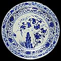 Dish, <b>fritware</b>, underglaze painted in cobalt blue with vine scroll in Chinese style, Uzbekistan (probably Samarqand), 1400-1450.
