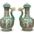 A pair of exportfamille vertephoenix head ewers and covers, Kangxi period (1662-1722)