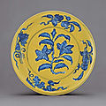 A fine Ming underglaze-blue and yellow-enamelled dish, Hongzhi six-character mark within double-circles and of the period