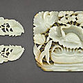 A celadon jade '<b>turtle</b>' plaque and a pair of celadon jade 'floral' ornaments, Yuan-Ming Dynasty (1279-1644)